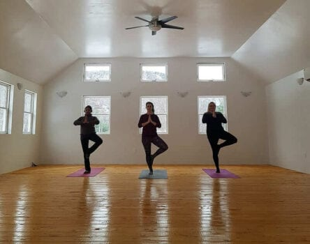 Photo of Three Women Practicing Yoga During a Retreat in Nova Scotia.